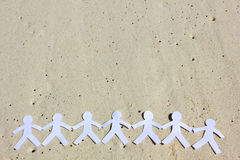 Paper Family on the beach Royalty Free Stock Photo