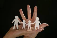 Paper family on black Stock Photo