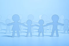 Paper family on blue background Royalty Free Stock Photos