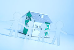 Paper family buys a home Royalty Free Stock Photo