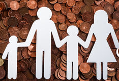Paper family on euro coins Royalty Free Stock Photography