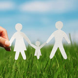 Paper Family on Grass. Family Royalty Free Stock Photo