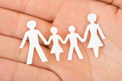 Paper family in hand Royalty Free Stock Photo