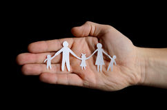 Paper family in hand Stock Photos