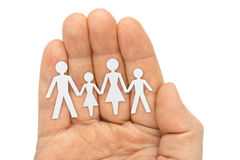 Paper family in hand Stock Images
