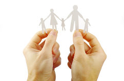 Paper family in hands. Isolated on white background Stock Photography