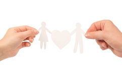 Paper family in hands. Isolated on a white background Stock Photos