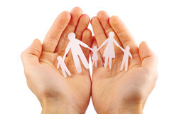 Paper family in hands. Isolated on white background Stock Photo