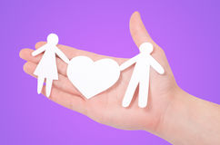 Paper family in hands. Happiness Royalty Free Stock Image