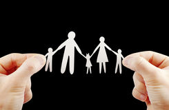 Paper family in hands Royalty Free Stock Image