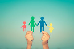 Paper family in hands stock photo