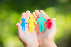 Paper family in hands royalty free stock photography