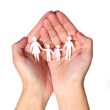 Paper Family in Hands isolated on white background. Family Stock Image