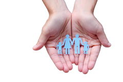 Paper family in hands isolated on white background welfare concept.  Stock Images