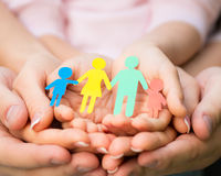 Paper family in hands Stock Images