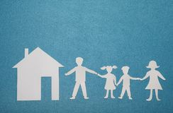 Paper family and house on blue textured background. Family and home concept. Insurance concept Royalty Free Stock Photography