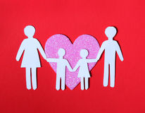 Paper Family in Pink Heart over on red background. Love, Kids Royalty Free Stock Photo