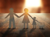 Paper family on wooden table at sunset Stock Image