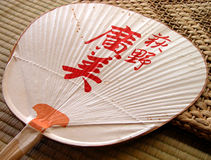 Paper fan. A characteristic Japanese paper fan on a tatami floor Royalty Free Stock Photo