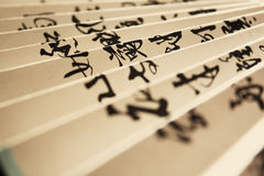 Paper fan with hieroglyphs Stock Image