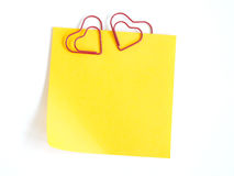 Paper are fastened by a paper clip. Heart Stock Photo