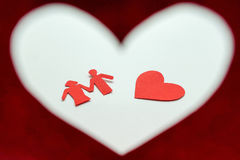 Paper of female and male in red heart. Paper of female and male in red Valentine`s heart royalty free stock image