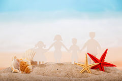 Paper figures, shells and starfishes Royalty Free Stock Photos