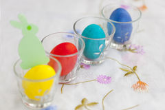 Paper figurine of green rabbit and several colorful easter eggs Royalty Free Stock Photography