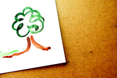 Paper file with painted green eco tree on table. Royalty Free Stock Photography