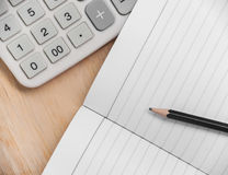 Paper for finance with pencil and calculator. On wooden background Stock Photography