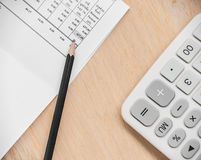 Paper for finance with pencil and calculator Royalty Free Stock Photo
