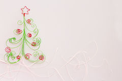 Paper fir tree. Paper christmas fir tree with red decoration on white background Royalty Free Stock Photography