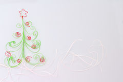 Paper fir tree. Paper christmas fir tree with red decoration on white background Royalty Free Stock Image