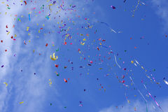 Paper firework. Colorful paper firework on blue sky backgroun royalty free stock image