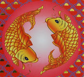 Paper fish. Two golden fishes on the wall royalty free stock images