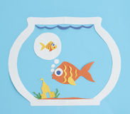 Paper fish cut-out dreaming of a friend Royalty Free Stock Images
