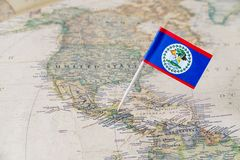Belize flag pin on world map. Paper flag pin of Belize on a world map showing neighboring countries. Belize, formerly British Honduras, is an independent Royalty Free Stock Images