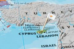 Cyprus map and flag pin. Paper flag pin of Cyprus on a world map showing neighboring countries. It is an island country in the Eastern Mediterranean. Travel Royalty Free Stock Image