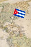 Cuba flag pin on a world map Royalty Free Stock Photos