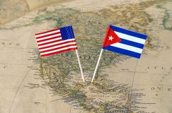 The United States of America and Cuba flag pins on a world map, political relations concept Stock Images