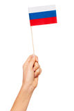 Paper flag of Russian Federation in woman`s hand. Small paper flag of Russian Federation in woman`s hand isolated on white Royalty Free Stock Photography
