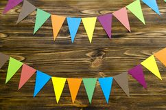 Paper  flags  party garland  on wooden background. Paper flags party garland on wooden background Stock Images