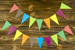 Paper  flags  party garland  on wooden background.  Stock Photos
