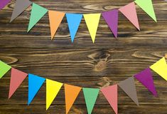 Paper  flags  party garland  on wooden background.  Royalty Free Stock Image