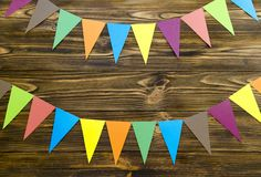 Paper  flags  party garland  on wooden background.  Stock Photo