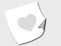 Paper on a floor with heart. A paper lying on a grey floor with a grey heart Royalty Free Stock Photography