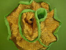 Paper flower. Golden paper flower isolated on green Stock Photography