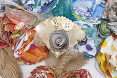 Paper Flower and Ribbon Literary Corsage. Corsage handcrafted from paper flowers, ribbon, and buttons in gold and pearl tones accented with newsprint. Pictured Stock Photography
