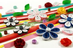 Paper and flowers. Colored paper and quilling flowers Stock Photos
