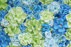 Paper flowers background. Artificial flowers made of paper background with green and blue tone Stock Photos